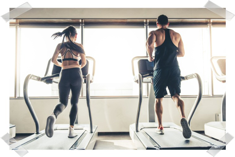 A woman and a man exercise running with treadmills.